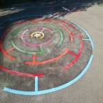 Removing Old Playground Markings in Alderbury 11
