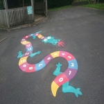 Removing Old Playground Markings in Abertridwr 10